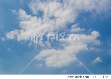 Blue sky with soft clouds background 73089176