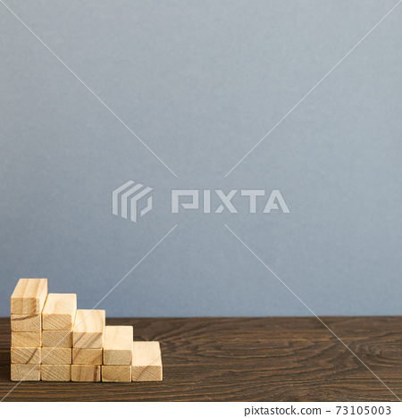 Wood block stairs on desk. gray background. Business development, growth, success concept 73105003