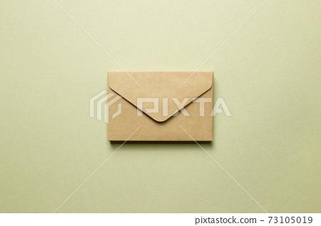 Kraft brown paper envelope on khaki background. top view, copy space 73105019