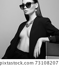fashion portrait of Beautiful sexy woman in sunglasses and jewelry 73108207