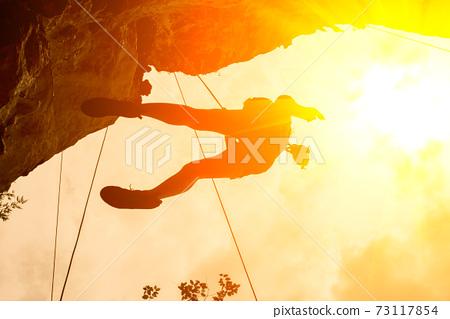 silhouette of mountain climber at riley beach, Krabi, Thailand 73117854