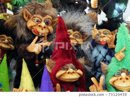 A bunch of different colorful little cute trolls 73120439
