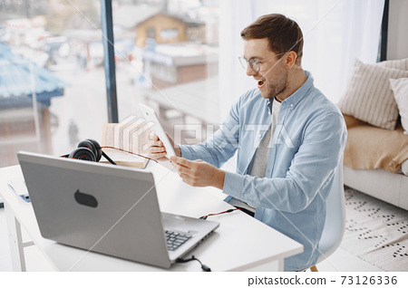 Male has lesson online e-learning in internet concept 73126336
