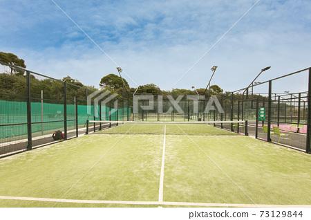 green tennis court 73129844