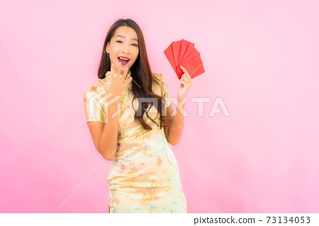 Portrait beautiful young asian woman with red envelopes in chinese new year concept 73134053