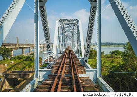 Historical Iron Bridge across the KaoPing River at Kaohsiung city, taiwan 73136599