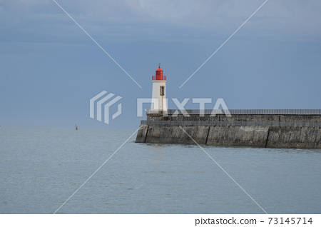 Lighthouse of grande jetee in les Sables d'Olonne in France. 73145714
