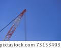 A large crane at a construction site in Ochanomizu, Chiyoda-ku, Tokyo 73153403