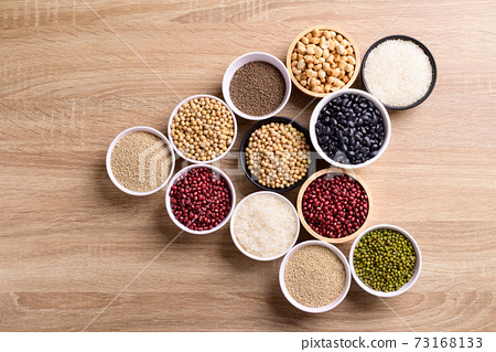 Various cereal grain in a bowl on wooden background 73168133