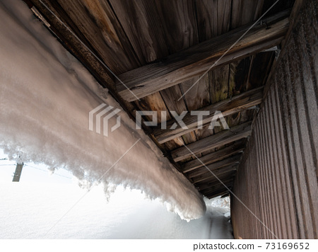 Image of winter roof snow removal work 73169652