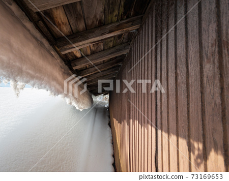 Image of winter roof snow removal work 73169653