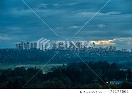 Overview of Metrotown cityscape on cloudy sky background 73177662