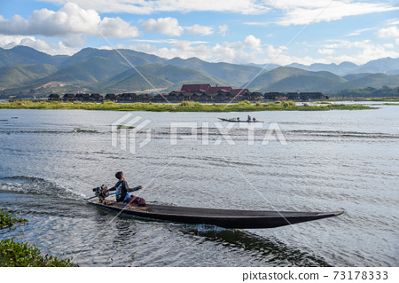 local man on the boat in Inle lake, Myanmar 73178333