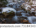 Clear stream of snowy landscape 73184343