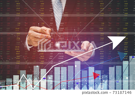 Businessman touchscreen graph Screen Icon of stock market ,Technology Process System Business with Investment and stock market concept gain and profits with faded number charts. 73187146