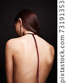 beautiful young woman with necklace on her naked back 73191353