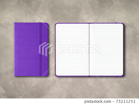 Purple closed and open lined notebooks on concrete background 73211251