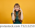 Headache grimacing pain holds the back of neck indicating location. Fatigue 73213250
