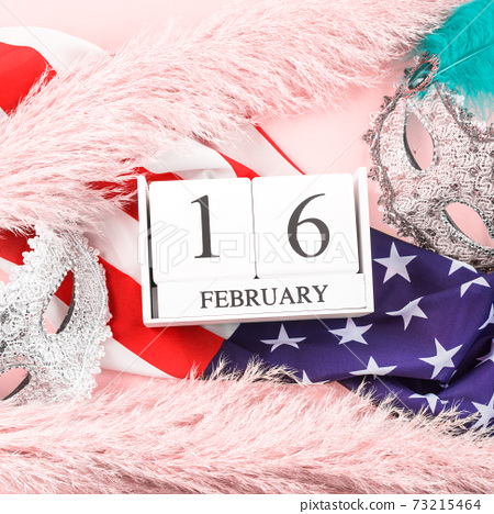 Mardi Gras masks with american flag and calendar 73215464