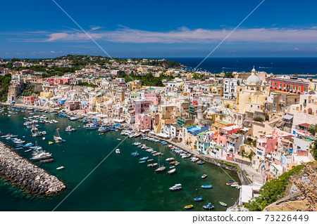 Corricella coast from the observation deck in the Terra Murata district of Procida, Italy 73226449