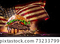 Tasty Burger with Waving American Flag 73233799