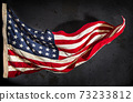 American flag boldly flying in the wind 73233812