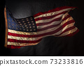 American flag boldly flying in the wind 73233816
