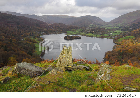 View from Loughrigg Fell over Grasmere with fells behind, Lake District 73242417