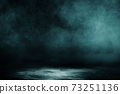 Studio dark room concrete floor grunge texture background with spot lighting and fog or mist in black background. 73251136