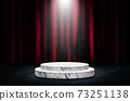 Round white podium or pedestal in studio dark room black concrete floor grunge texture with red certain in background. 73251138
