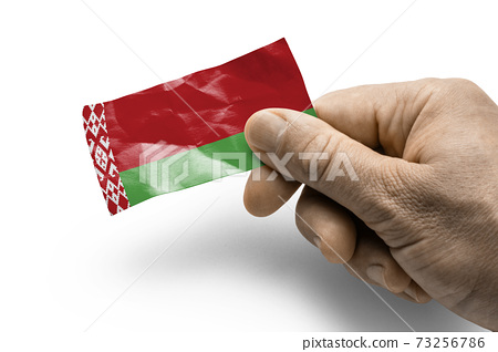 Hand holding a card with a national flag the Belarus 73256786