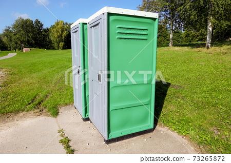 Public toilet outside in park in summer 73265872