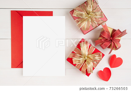 Blank postcard and letter and gift box and heart shape on wooden table, mockup greeting card. 73266503