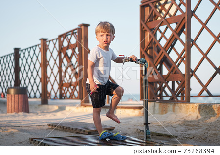 Caucasian boy standing beach. Childhood summertime. Family vacation 73268394