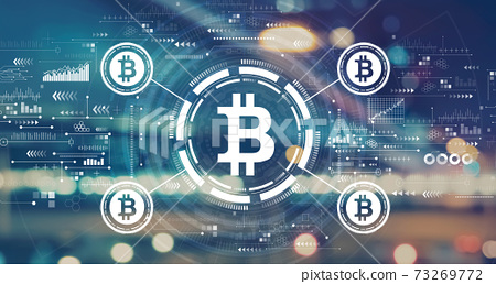 Bitcoin theme with blurred city lights 73269772