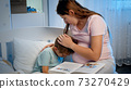 Young pregnant mother hugging and soothing her crying little boy lying in bed at night. Caring and loving parent hugging child 73270429