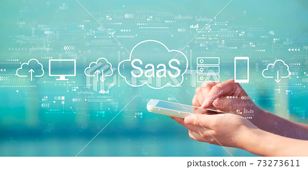 SaaS - software as a service concept with smartphone 73273611