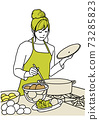 在廚房裡做飯的年輕女子 73285823