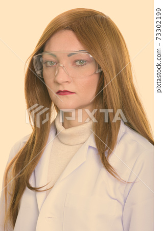 Studio shot of face of woman doctor wearing protective glasses 73302199