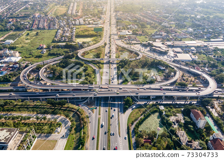Aerial view of road interchange or highway intersection 73304733