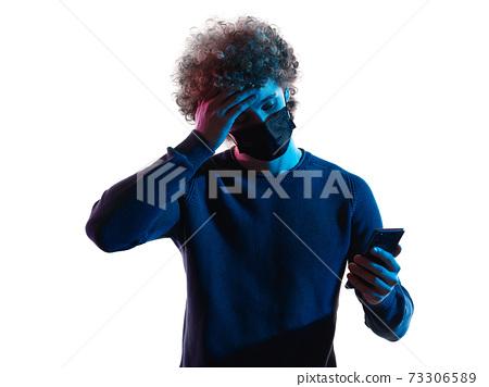 young man headshot face mask portrait shadow white background telephone sick 73306589