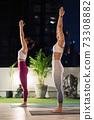 Asian women do yoga in city at night 73308882