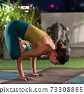 Asian woman do yoga in city at night 73308885