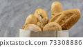 Bread variety in disposalable paper bag. Panoramic 73308886