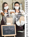 waitress wear protective face mask hold food bag 73308887