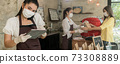 Panorama Waitress with face mask take order for curbside pick up and takeout. 73308889