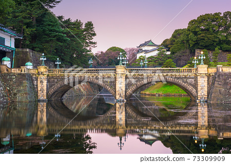 Tokyo, Japan at the Imperial Palace moat and bridge 73309909