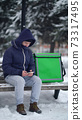 delivery boy with an insulated backpack looking for the client's address in the delivery app 73317495