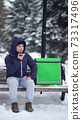 food delivery courier waiting for a customer's address and records a voice message on the phone 73317496