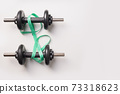 Sport dumbbells and measuring tape on grey background. Top view, copy space. 73318623